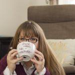 Andrea Schrag, Kansas Personal Branding Photographer drinking coffee