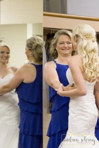 bride getting ready with mother of the bride in post about the perfect timeline for wedding photos