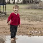 boy standing in puddle